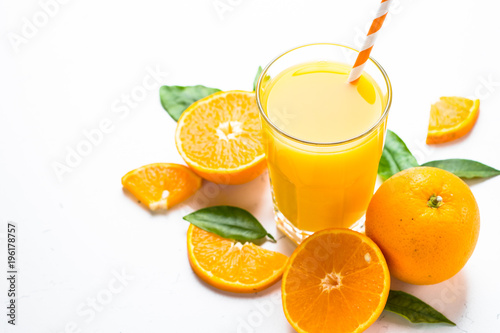 Foto op Canvas Sap Orange juice in glass on white.