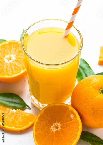 Orange juice in glass on white.