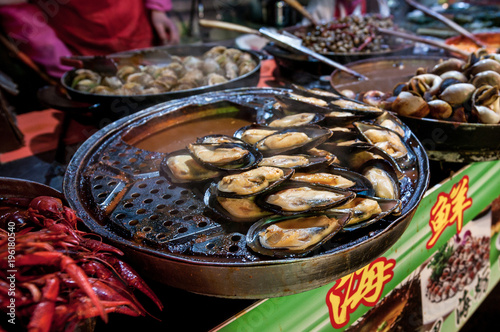 Foto op Canvas Peking seafood on street food stall at Wangfujing Snack Street in Dongcheng District, Beijing, China