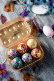 homemade decorated easter eggs in an egg box - 196183107
