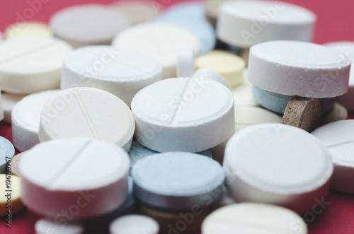 Foto op Plexiglas Apotheek Round multi-colored pill close-up, soft focus