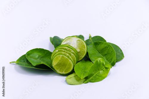 fresh green lemons on white background - 196191983