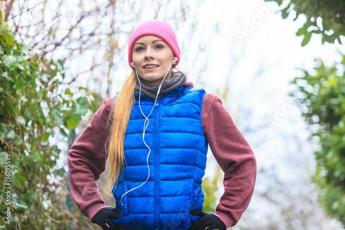 Deurstickers Jogging Woman wearing sportswear exercising outside during autumn