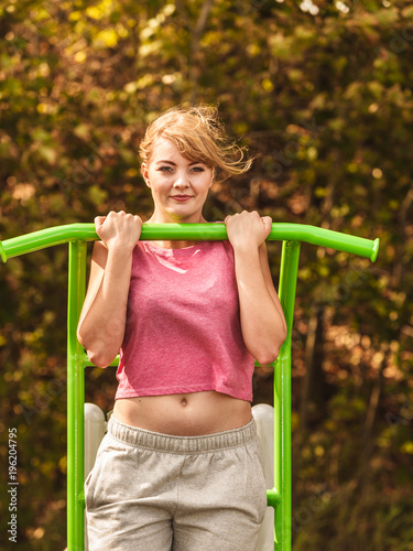 Fotobehang Fitness Active woman exercising on ladder outdoor.