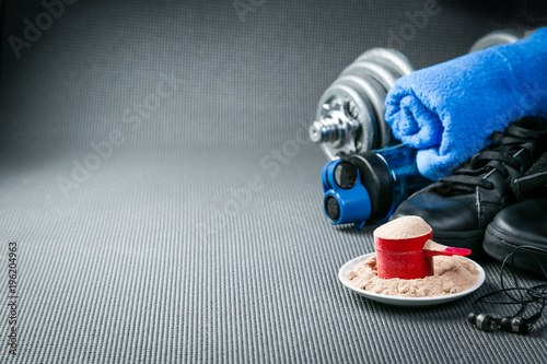 Sport concept - gym supplies on yoga mat background