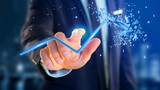 Businessman holding a Financial arrow going up and explosing at the end - 3d rendering - 196206501