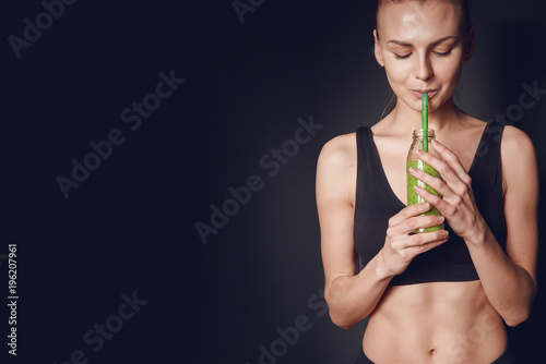 Poster Sap sports nutrition. the girl drinks smoothies