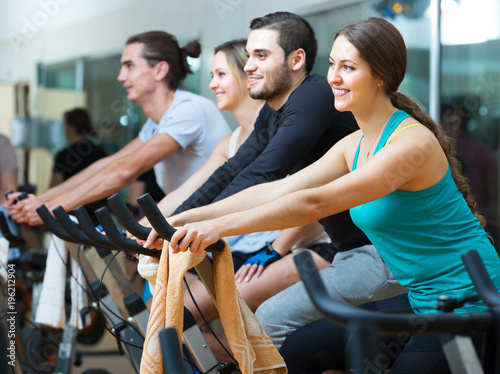 People training on exercise bikes