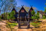 Ban Dam Kalae Kieo Fa is a vintage triplets house architecture. The black house is in Baan Dam Museum - 196221760