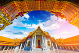 View through the gate to Wat Benchamabophit in Bangkok City, Thailand.. - 196232768