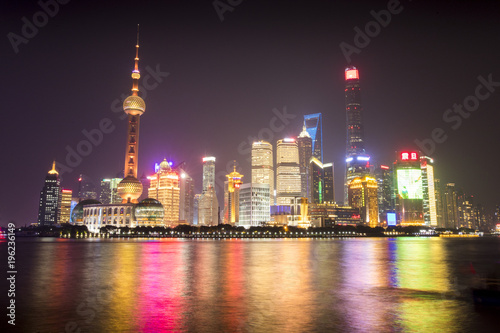 Foto op Plexiglas Shanghai The lights of Shanghai, China reflect off the Huangpu River in a Downtown area known as The Bund.