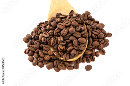 Fotobehang Koffiebonen Coffee grains in a wooden spoon. Roasted coffee beans close-up in a wooden spoon.