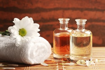 Candles, oils and towels - massage or aromatherapy