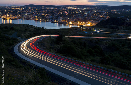Fotobehang Nacht snelweg A lookout at dusk with light trails overlooking a city
