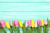 Bouquet of tulips on mint wooden table - 196256795