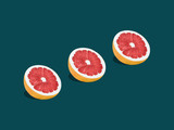 Grapefruit in pop art style Three halves of ripe grapefruit are lying on a turquoise background Trendy photo with text space