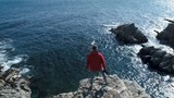 Traveler Standing On The Edge Of The Cliff - 196264960