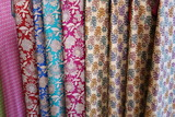 Fabric with oriental ornaments. Multicolored textiles in the bazaar in Dubai.