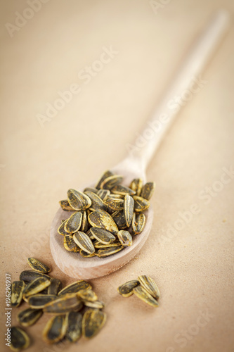 Spoon with roasted sunflower seeds