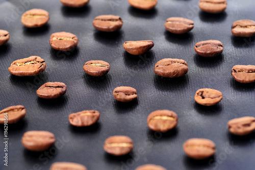 Tuinposter Koffiebonen Coffee beans on the dark stone background