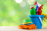 Cleaning concept - cleaning supplies on wood background - 196301153