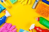 Cleaning concept - cleaning supplies on wood background - 196301190