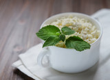 Cottage cheese with mint in white bowl  close up - 196308947