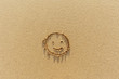 Smiley im Sand