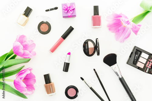 Beauty concept with tulips bouquet, cosmetics and gift box on white background. Top view. Flat lay feminine desk with flowers - 196315554