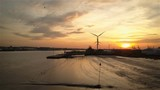 Tilbury Docks at sunset; Essex, England; aerial drone reverse - 196328540