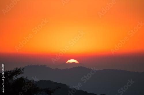 Deurstickers Oranje eclat sunset in winter