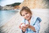 Girl Holding Stones