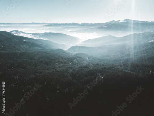 Gray traffic Sunrise over Carpathian mountains, forest, blue tones, aerial view, drone photo