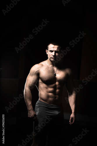 Portrait of a bodybuilder on a black background