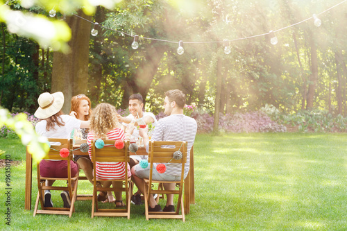 Smiling friends during garden party - 196358120