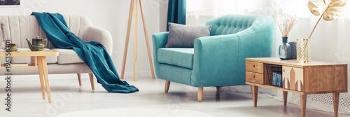 Leinwandbild Motiv Turquoise armchair in living room