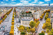 Paris, France - Champs Elysees cityscape. View from Arc de Triomphe. Blue sky with clouds in autumn.
