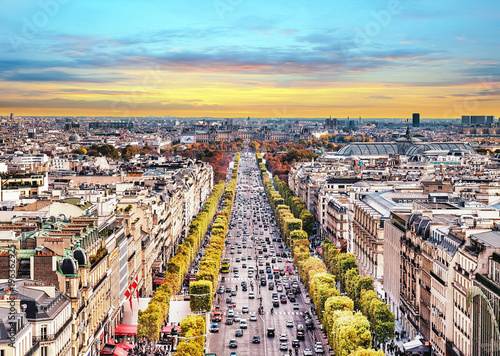 Fridge magnet Paris, France - Champs Elysees cityscape. View from Arc de Triomphe. Sunset sky with clouds in autumn.