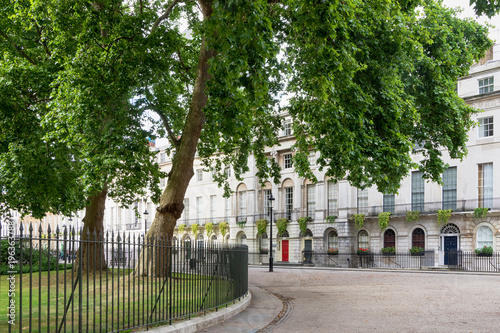 Foto op Canvas Londen Town house with appartaments on a street with park, London, UK