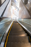 Escalators running down in a white building