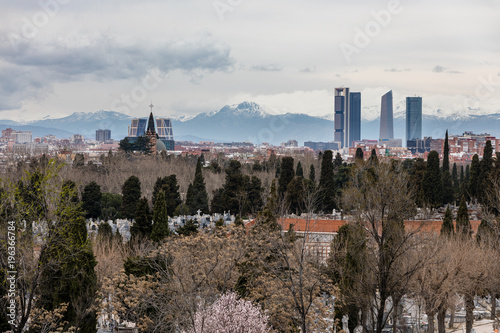 Papiers peints Madrid Skyline of Madrid with skyscrapers the four towers and snowy mountains in the background