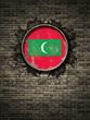 Old Maldives flag in brick wall