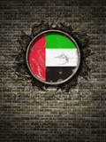 Old United Arab Emirates flag in brick wall