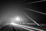 long exposure of foggy night, black and white on iron bridge of the city