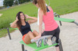 Woman doing sit ups using park equipment