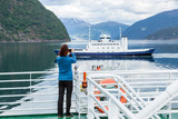 Tourist woman on liner taking photo, Norway - 196380363