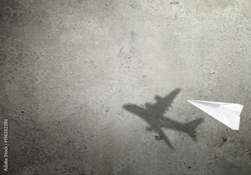 Paper plane shadow concept