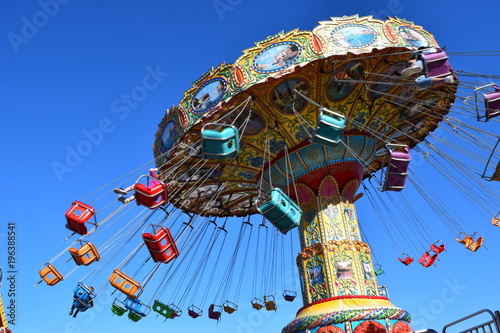Fotobehang Amusementspark Colorful carnival ride at amusement park, summer day.