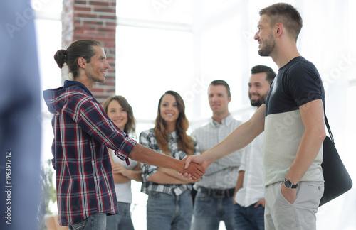 Foto Murales closeup of handshake of business partners
