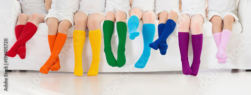 Kids with colorful socks. Children footwear. - 196405720